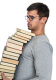 Giovane con un mucchio dei libri in mani Fotografie Stock Libere da Diritti