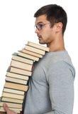 Giovane con un mucchio dei libri in mani Immagine Stock Libera da Diritti