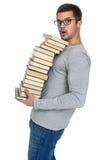 Giovane con un mucchio dei libri in mani Fotografia Stock Libera da Diritti