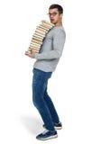 Giovane con un mucchio dei libri in mani Immagini Stock