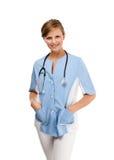 Giovane condizione del medico isolata su priorità bassa bianca Immagine Stock