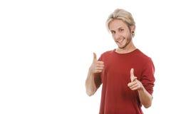 Giovane contento che dà pollice su Immagini Stock