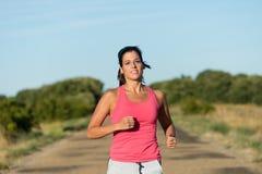 Giovane correre sportivo della donna all'aperto Fotografia Stock