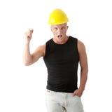 Giovane costruttore arrabbiato bello. Immagine Stock
