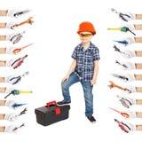 Giovane costruttore del ragazzo nel casco della costruzione Fotografia Stock