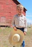 Giovane cowboy sorridente Fotografia Stock Libera da Diritti