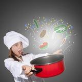 Giovane cuoco unico con il vaso Fotografie Stock Libere da Diritti