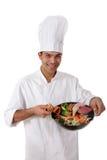 Giovane cuoco unico nepalese dell'uomo, alimento orientale Immagine Stock