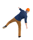 Giovane d'equilibratura o eviti la caduta fotografia stock