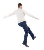 Giovane d'equilibratura o eviti la caduta immagine stock libera da diritti