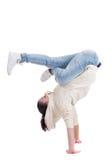 Giovane dancing adolescente della donna sul bianco Immagine Stock