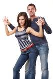 Giovane dancing piacevole delle coppie sulla priorità bassa bianca Fotografie Stock Libere da Diritti