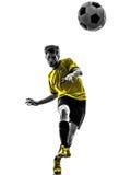 Giovane del giocatore di football americano brasiliano di calcio che dà dei calci alla siluetta Fotografia Stock Libera da Diritti
