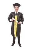 Giovane diploma e sorridere della tenuta dell'uomo di graduazione Fotografia Stock