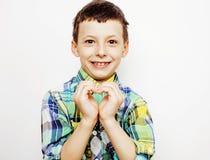 Giovane domandarsi grazioso del bambino del ragazzino, posante il fronte emozionale isolato su fondo bianco, gesture la fine sorr fotografia stock libera da diritti