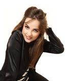 Giovane donna adorabile in un rivestimento Fotografie Stock