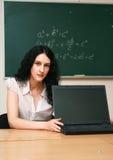 Giovane donna alla lezione Fotografie Stock