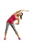 Giovane donna allegra che fa gli esercizi Fotografie Stock Libere da Diritti