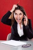 Giovane donna arrabbiata sul lavoro Fotografia Stock Libera da Diritti