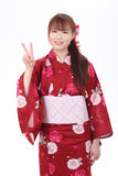 Giovane donna asiatica in kimono Fotografie Stock