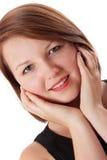 Giovane donna attraente che sorride alla macchina fotografica Immagine Stock