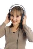 Giovane donna attraente con le cuffie Fotografia Stock Libera da Diritti