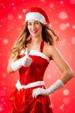 Giovane donna attraente in costume di Santa Claus con i pollici su Immagini Stock Libere da Diritti