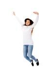 Giovane donna bella di salto felice Immagini Stock