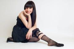 Giovane donna in calze violente Fotografie Stock