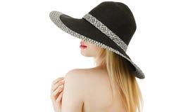 Giovane donna in cappello fotografie stock