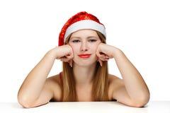 Giovane donna in cappello del Babbo Natale Fotografia Stock Libera da Diritti