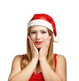 Giovane donna in cappello di Santa con il gesto espressivo Immagini Stock