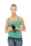 Giovane donna caucasica con il raccoglitore vuoto fotografie stock