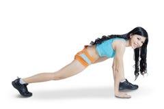 Giovane donna che allunga il suo corpo Fotografia Stock Libera da Diritti