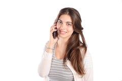 Giovane donna che comunica sul telefono Immagine Stock Libera da Diritti