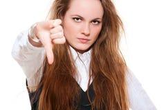 Giovane donna che dà i pollici giù Fotografie Stock Libere da Diritti