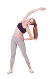 Giovane donna che fa gli esercizi Fotografia Stock
