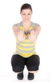 Giovane donna che fa gli esercizi di forma fisica isolati su fondo bianco Fotografie Stock