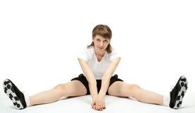 Giovane donna che fa gli esercizi di sport Fotografia Stock Libera da Diritti