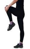 Giovane donna che fa le esercitazioni di piedini Fotografie Stock Libere da Diritti
