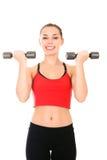 Giovane donna che fa un allenamento di forma fisica Fotografia Stock