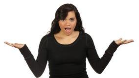 Giovane donna che fa un gesto interrogante immagini stock