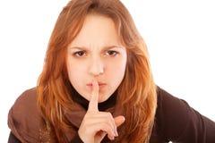 Giovane donna che gesturing silenzio Fotografie Stock