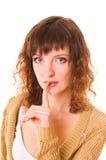 Giovane donna che gesturing silenzio Fotografia Stock Libera da Diritti