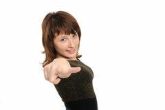 Giovane donna che indica la sua barretta fotografia stock