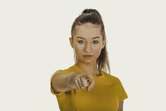 Giovane donna che indica su voi Immagini Stock Libere da Diritti