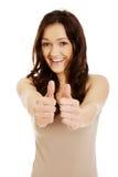 Giovane donna che mostra i pollici in su Fotografia Stock Libera da Diritti