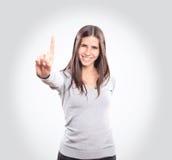 Giovane donna che mostra un dito immagine stock