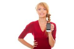 Giovane donna che mostra uno smartphone Immagine Stock Libera da Diritti