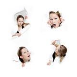 Giovane donna che pigola attraverso il foro in documento fotografia stock